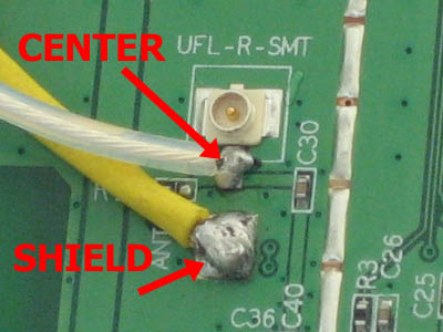 Soldiering antenna connections inside the Buffalo router
